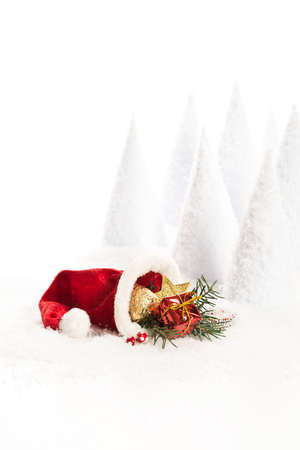 bonnet: Santa Claus bonnet with decoration an artificial snow landscape Stock Photo