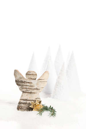 birch bark: christmas angle made from birch bark with artificial snow, trees and decoration