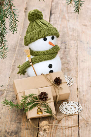 little snow man with presents and christmas decoration