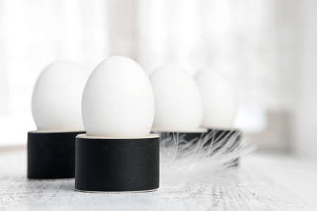 egg cup: white eggs on black egg cup