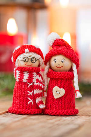 elves: two wooden christmas elves in red knitted outfits