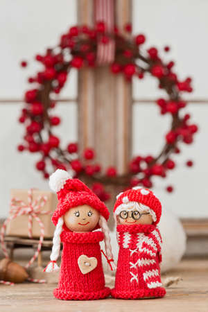 elves: two cute christmas elves dressed in red knitted clothes Stock Photo