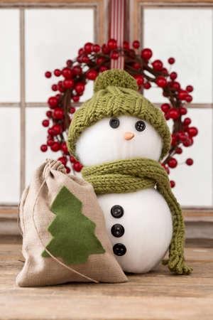 stil: snow man with christmas decoration Stock Photo