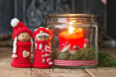 elves: two christmas elves with candle and decoration Stock Photo
