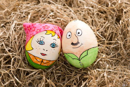 two easter eggs lie in the hay Stock Photo