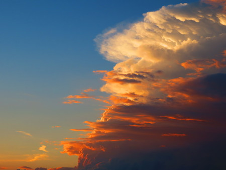 towering: White cloud is towering over red in the sky