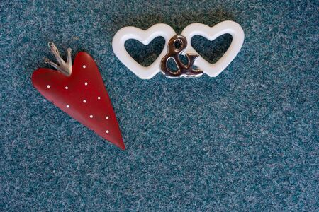 Valentines day, two white hearts, And You symbols and strawberry heart on blue green textured background. High angle view, close up with space for text.