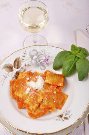 Ravioli with ricotta and spinach with ingredients for preparing flour and eggs and Parmesan photo