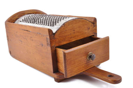 old old wooden cheese grater, pierced with metal hand and tray Stock Photo - 13507302