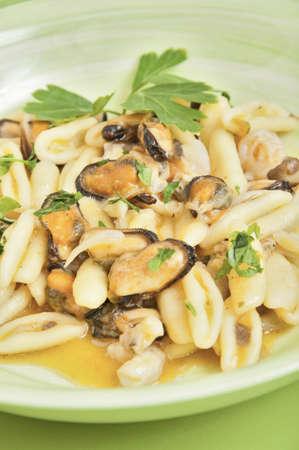 cicatelli Molise-style seafood with shellfish pot of green photo