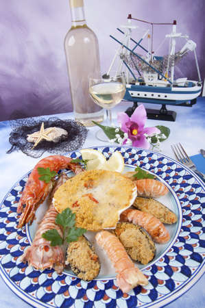 lobster tail: scallops baked with mixed shellfish, mussels, lobster tail, shrimp, corn on the cob Stock Photo