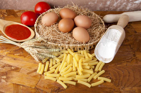 low-protein pasta  spaghetti  with flour and ingredients for the dressing Stock Photo - 14015390