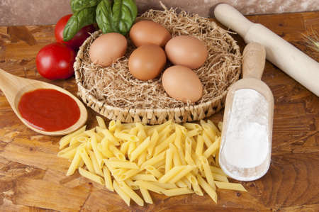 low-protein pasta  spaghetti  with flour and ingredients for the dressing Stock Photo - 14015389