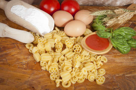 low-protein pasta  spaghetti  with flour and ingredients for the dressing Stock Photo - 14015141