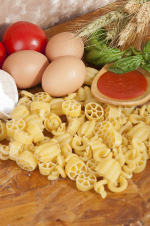 low-protein pasta  spaghetti  with flour and ingredients for the dressing photo