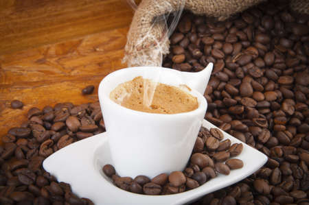 buccal: steaming hot cup of coffee with beans