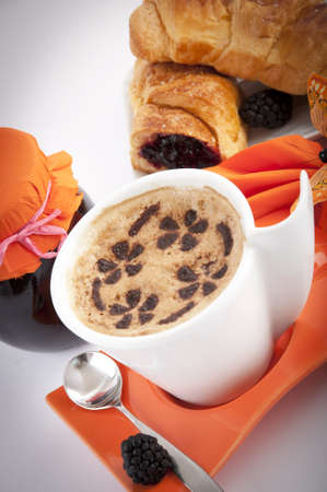 buccal: cup of cappuccino with a croissant with jam Stock Photo