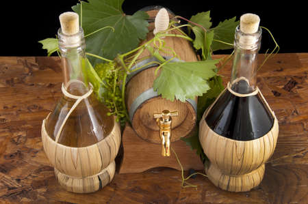 In oak casks with vines and grapes white and black background with white wine and whistles photo