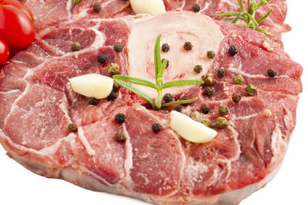 veal osso buco with rosemary and the ingredients for the dressing Stock Photo - 14730897