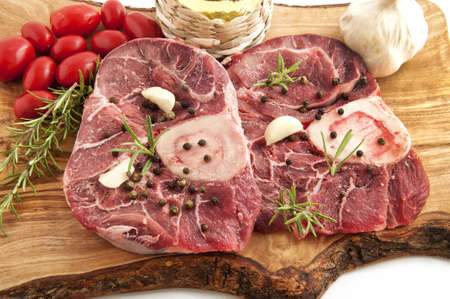 veal osso buco with rosemary and the ingredients for the dressing Stock Photo - 14730957