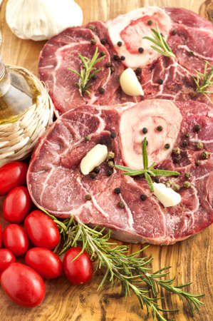 veal osso buco with rosemary and the ingredients for the dressing photo