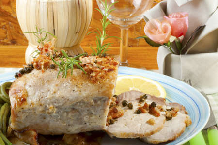 roast pork with green pepper and rosemary photo
