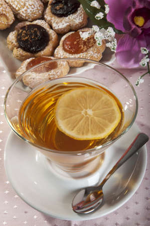 teas: Tea with lemon and pastries and embroidered tovglietta