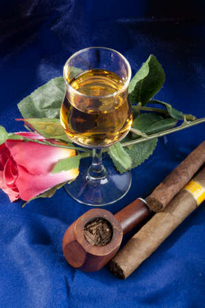 Brandy with a pipe and cigars, with different colored backgrounds and tobacco photo