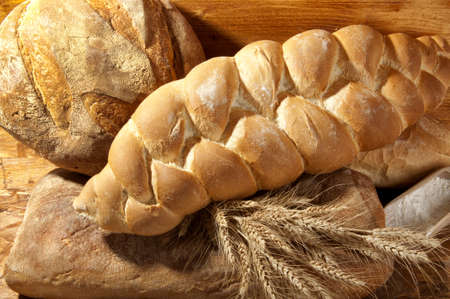 composition of white bread with ears of wheat photo