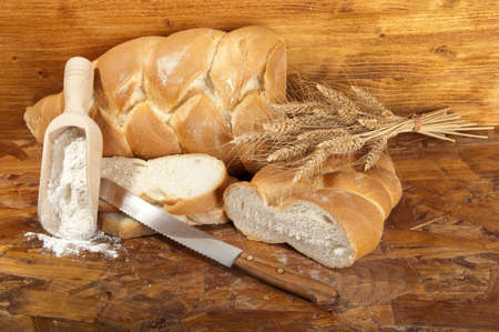 braid bread slices with flour and wheat photo