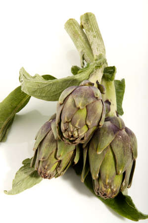 fresh artichokes with leaves and stems Stock Photo