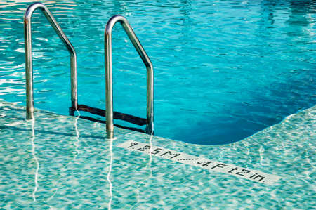 Steel staircase and pool Stock Photo