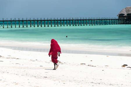 Masai on the white beach on the island of Zanzibar Stock Photo