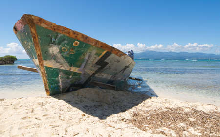 Wreck on white tropical beach - Le Gosier island - Guadeloupe Caribbean sea