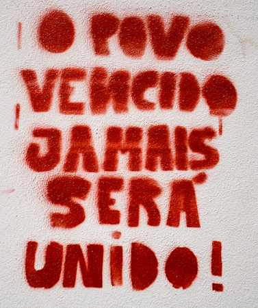 defeated: Portuguese graffiti - defeated people will never be united Stock Photo