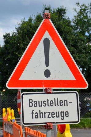 German sign - Warning, construction vehicles Stock Photo