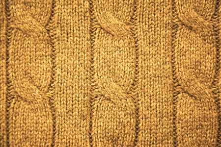 cable stitch: Gold cable knit close-up Stock Photo