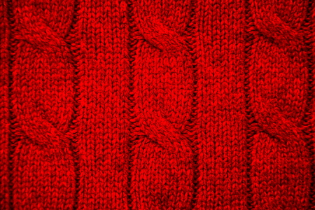 cable stitch: Red cable knit close-up