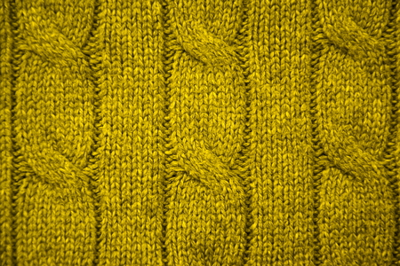 cable stitch: Yellow cable knit close-up