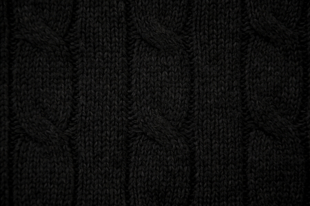 cable stitch: Black cable knit close-up