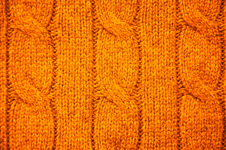 cable stitch: Orange cable knit close-up Stock Photo