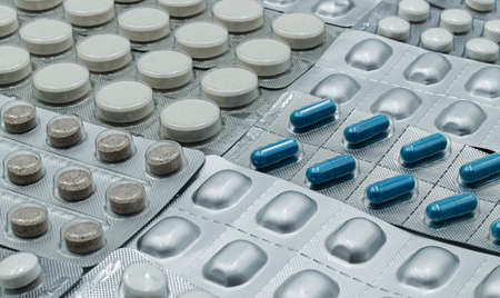 A lot of blisters with different pharmaceutical pills