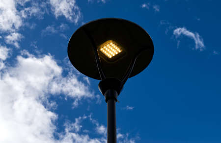 Street lamps with modern Led light on sky background