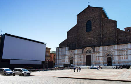 Outdoor cinema with white projection screen in Piazza Maggiore. Bologna, Italy.