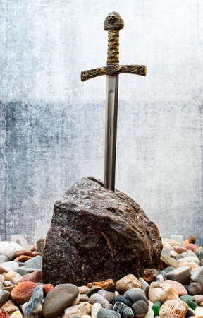 Excalibur, the mythical sword in the stone of King Arthur