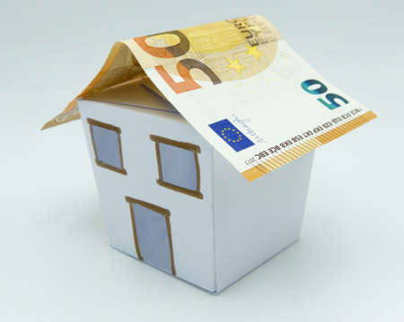 House with euros banknotes as rooftops