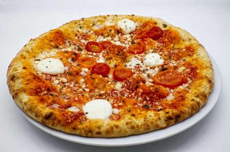 Italian Pizza with tomatoes and Buffalo Mozzarella cheese from Campania region.
