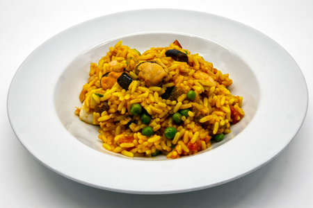 Traditional spanish Paella with seafood and chicken. Archivio Fotografico