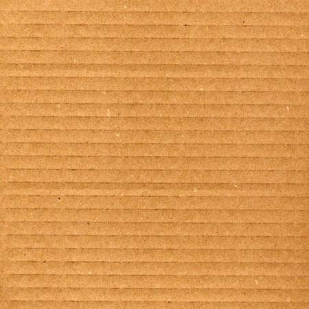Brown corrugated cardboard sheet background photo