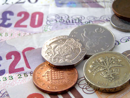 money pounds: British Pounds banknotes and coins
